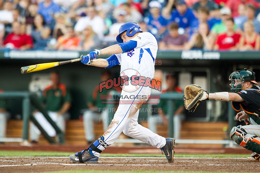 Florida Gators designated hitter JJ Schwarz (22) swings the bat against the Miami Hurricanes in the NCAA College World Series on June 13, 2015 at TD Ameritrade Park in Omaha, Nebraska. Florida defeated Miami 15-3. (Andrew Woolley/Four Seam Images)
