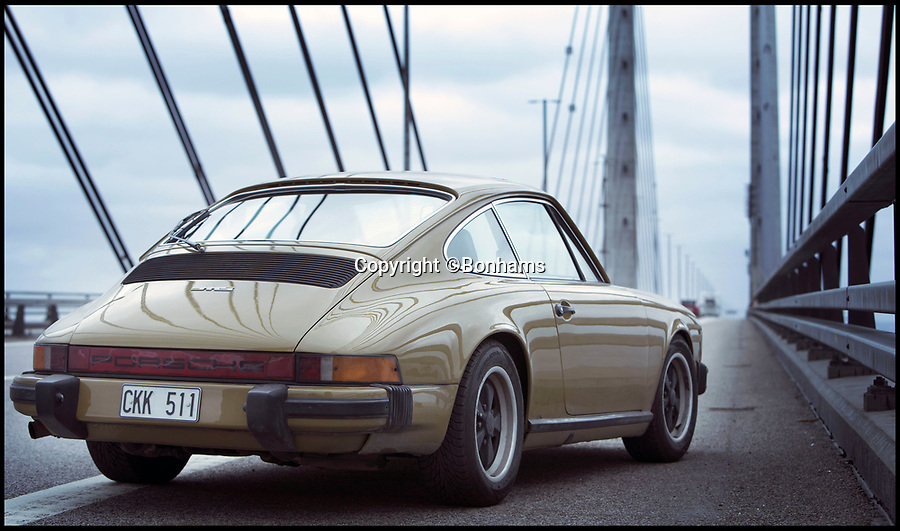 BNPS.co.uk (01202)558833Pic: Bonhams/BNPS<br /> <br /> The Porsche car driven by blonde police detective Saga Noren in the Scandanavian TV crime drama The Bridge has been put up for sale.<br /> <br /> The distinctive olive green sports motor was bought by the production company behind the hugely successful show in 2012 and has appeared in all four series.<br /> <br /> The producers have already announced there will not be making anymore series of The Bridge, as a result they are getting rid of the 1977 Porsche 911S with a pre-sale estimate of £30,000.