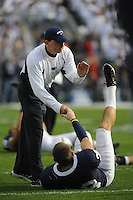 18 October 2008:  Penn State defensive coordinator and acting head coach Tom Bradley shakes hands with Drew Astorino during warm ups.  The Penn State Nittany Lions defeated the Michigan Wolverines 46-17 October 18, 2008 at Beaver Stadium in State College, PA..
