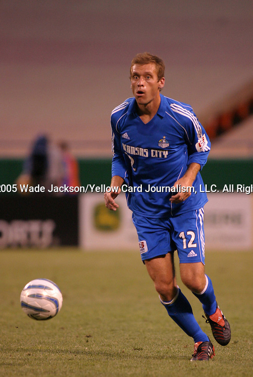 28 May 2005, Jimmy Conrad of the Wizards looks upfield for to make a pass.  The MLS Kansas City Wizards shut out the Earthquakes by a score of 1-0 in a hard fought regular season MLS match at Arrowhead Stadium, Kansas City, Missouri.  .. ..
