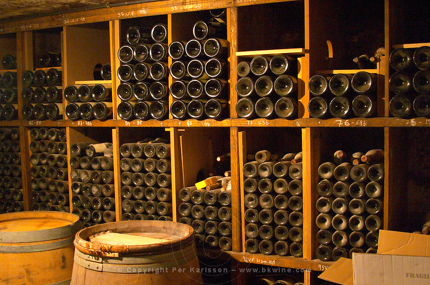 Older vintages of wine aging in the cellar. Alain Voge, Cornas, Ardeche, Ardèche, France, Europe