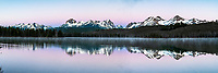 Sunrise at Little Redfish Lake, a touch of rose to color the morning scene.  The Sawtooth Range reflection in the still water of the lake. <br />