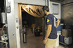 Half-Acre Beer Company president Gabriel Magliaro, 31, opens the company's walk-in refrigerator where kegs of beer are kept at 4257 N. Lincoln Ave. in Chicago, Illinois on June 13, 2009.