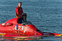 "Shaun Cassidy, A-73 ""CP Racing"", (2.5 Mod class hydroplane) is towed in after contact on the race course."