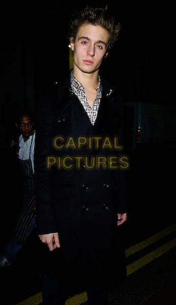 MAX IRONS.The Tatler's Little Black Book launch party, 24 nightclub, 24 Kingsley St., London, UK..November 9th, 2006.Ref: CAN.half length black coat  Jeremy Irons' son.www.capitalpictures.com.sales@capitalpictures.com.©Can Nguyen/Capital Pictures