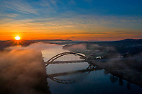 This frosty December morning, I found a most beautiful sunrise along with white fluffy clouds over the 360 Pennybacker Bridge as steam rises from the glass-like waters of Lake Austin.
