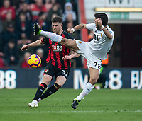 Bournemouth's Chris Mepham (left) crosses the ball despite the attentions of Wolverhampton Wanderers' Joao Moutinho (right) <br /> <br /> Photographer David Horton/CameraSport<br /> <br /> The Premier League - Bournemouth v Wolverhampton Wanderers - Saturday 23 February 2019 - Vitality Stadium - Bournemouth<br /> <br /> World Copyright © 2019 CameraSport. All rights reserved. 43 Linden Ave. Countesthorpe. Leicester. England. LE8 5PG - Tel: +44 (0) 116 277 4147 - admin@camerasport.com - www.camerasport.com