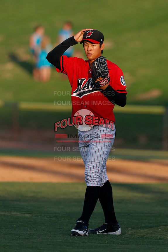 Seon Gi Kim #11 of the High Desert Mavericks pitches against the Visalia Rawhide at Stater Bros. Stadium on July 20, 2013 in Adelanto, California. High Desert defeated Visalia, 7-4. (Larry Goren/Four Seam Images)