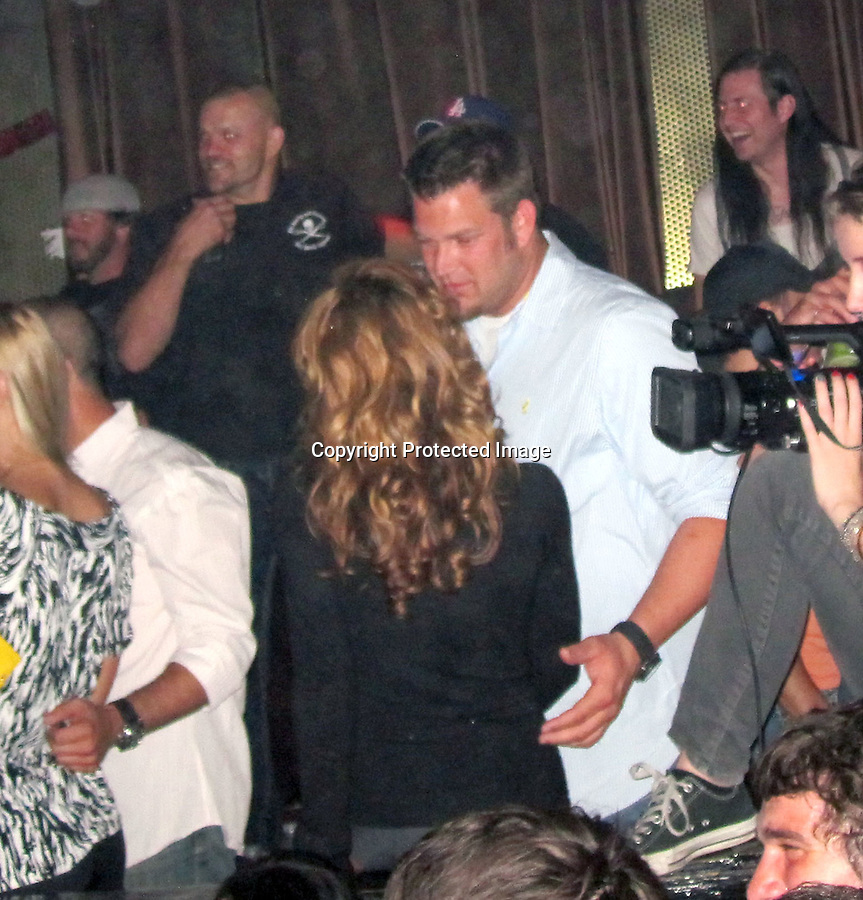 "..10-19-09 .Exclusive Monday Night ..Karina Smirnoff partying with her new man Brad Penny who's a. Pitcher for the San Francisco Giants. Chuck Liddell was also with them at the table. The couple went to watch the 1980's cover band Steel Panther at the key club in Hollywood. Tmz reported, ""The ""Dancing with the Stars"" pro -- who just broke up with ex-fiance Maksim Chmerkovskiy -- was all over the baseball player during the Steel Panther show at the Key Club..She may be a professional hip-shaker, but the only dancing these two were doing was with their tongues.""..AbilityFilms@yahoo.com.805-427-3519.www.AbilityFilms.com"
