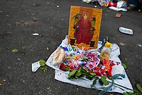 An altar of Santa Muerte (Holy Death), surrounded by offerings, is seen placed on the street during a religious pilgrimage in Tepito, Mexico City, Mexico, 1 April 2018. The religious cult of Santa Muerte is a fusion of Aztec death worship rituals and Catholic beliefs. Born in lower-class neighborhoods of Mexico City, it has always been closely associated with crime. In the past decades, original Santa Muerte followers, such as prostitutes, pickpockets and street drug traffickers, have merged with thousands of ordinary Mexican Catholics. The Holy Death veneration, offering a spiritual way out of hardship in modern society, rapidly expanded. Although the Catholic Church still considers Santa Muerte followers the devil worshippers, on the first day of every month, crowds of Santa Muerte believers fill the streets of Tepito. Holding statues of Holy Death clothed in a long robe, they pray for healing, protection, money or any other favor in life.