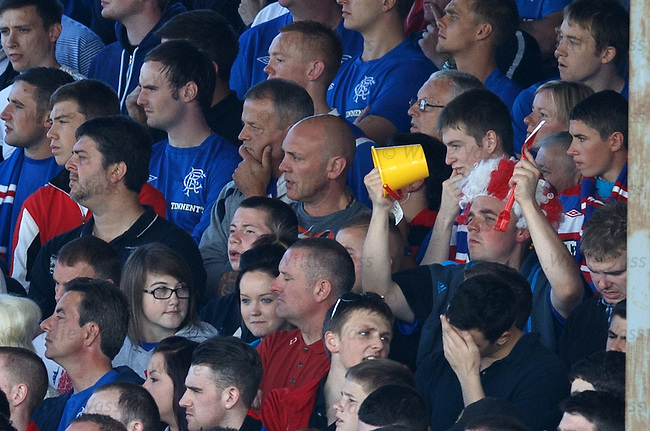 The guy in front just realised he forgot to bring his bucket, spade and wig along to the match. Luckily the bloke behind him remembered the essentials.