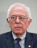 United States Senator Bernie Sanders (Independent of Vermont), a candidate for the Democratic nomination to be President of the United States, listens to one of the speakers after making remarks as he hosts a Conference on the Greek debt crisis in the Hart Senate Office Building in Washington, DC on Thursday, July 30, 2015. <br /> Credit: Ron Sachs / CNP