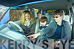 Paula Luck owner of the first electric car in Europe with her Children Benjamin, Millie and Harry.
