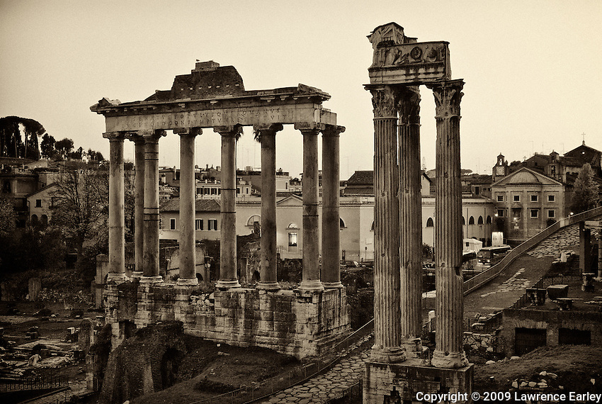 Columns and pediment of the ruined Temple of Saturn, Roman Forum, Rome.