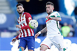 Atletico de Madrid's Yannick Carrasco (l) and Granada Club de Futbol's Cristiano Biraghi during La Liga match. April 17,2016. (ALTERPHOTOS/Acero)