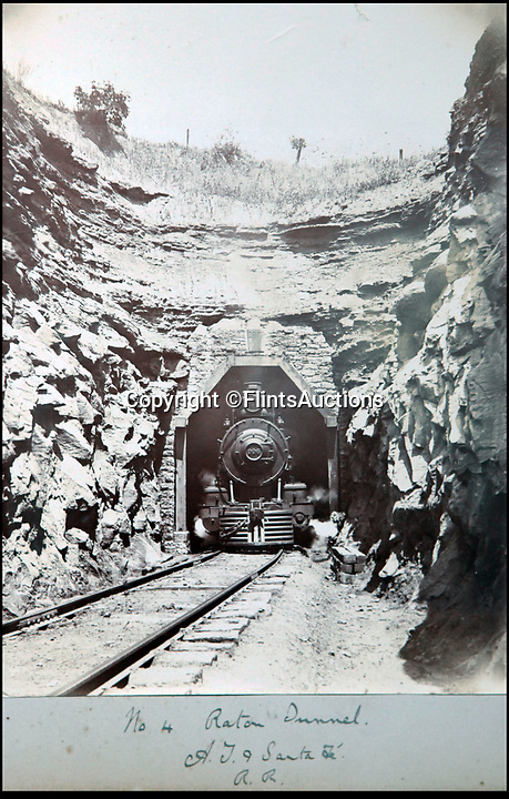 BNPS.co.uk (01202 558833)<br /> Pic: FlintsAuctions/BNPS<br /> <br /> No 4 loco emerges from a tunnel near Raton on the Santa Fe railroad.<br /> <br /> Unseen album reveals the life of a cowboy in the real wild west...<br /> <br /> Fascinating previously unseen early photos of cowboys in the Wild West have come to light 130 years later.<br /> <br /> They show life on the ranches of Colorado and New Mexico in the vast expanses of the south west US in the 1880s.<br /> <br /> One dramatic image captures the thrilling moment a group of cowboys ride towards the camera with hats held aloft.<br /> <br /> The photos are thought to have been taken by a British farmhand who travelled Stateside in the late 19th century to earn a living.