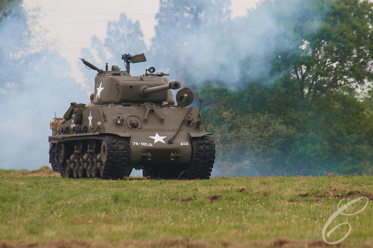 Reenactors showcase World War II tanks, half-tracks and support vehicles during the Museum of the America G.I.'s annual Open House on March 29, 2008 in College Station, Texas. A M4 Sherman tank named Gideon takes the field during the reenactment.
