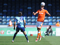 Blackpool's Ben Heneghan heads the ball despite the attentions of Wycombe Wanderers' Randell Williams<br /> <br /> Photographer Kevin Barnes/CameraSport<br /> <br /> The EFL Sky Bet League One - Wycombe Wanderers v Blackpool - Saturday 4th August 2018 - Adams Park - Wycombe<br /> <br /> World Copyright &copy; 2018 CameraSport. All rights reserved. 43 Linden Ave. Countesthorpe. Leicester. England. LE8 5PG - Tel: +44 (0) 116 277 4147 - admin@camerasport.com - www.camerasport.com