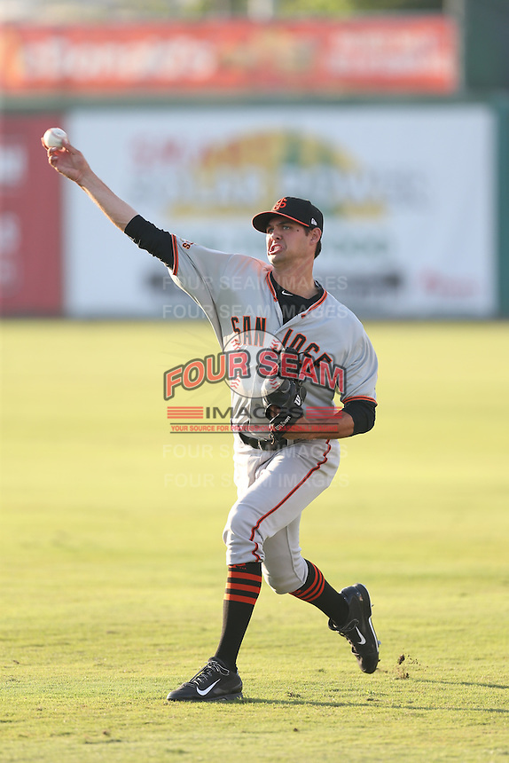 Tyler Beede (15) of the San Jose Giants warms up before pitching during a game against the Inland Empire 66ers at San Manuel Stadium on May 30, 2015 in San Bernardino, California. Inland Empire defeated San Jose, 6-4. (Larry Goren/Four Seam Images)
