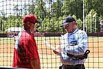 RALEIGH, NC - MAY 07: NC State head coach Shawn Rychcik (left) talks with home plate umpire Chris Tehonica (right). The North Carolina State University Wolfpack hosted the University of Louisville Cardinals on May 7, 2017, at Dail Softball Stadium in Raleigh, NC in a Division I College Softball game. Louisville won the game 7-0.