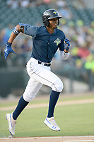 Shortstop Shervyen Newton (3) of the Columbia Fireflies runs out a batted ball in a game against the Augusta GreenJackets on Saturday, June 1, 2019, at Segra Park in Columbia, South Carolina. Columbia won, 3-2. (Tom Priddy/Four Seam Images)