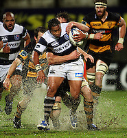 Jason Eaton wraps up Auckland halfback Taniela Moa. Air New Zealand Cup rugby match - Taranaki v Auckland at Yarrows Stadium, New Plymouth, New Zealand. Friday 9 October 2009. Photo: Dave Lintott / lintottphoto.co.nz