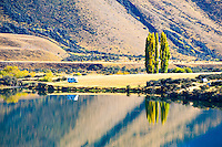 Early Morning Reflections at Lake Moke DOC Campsite, Queenstown, South Island, New Zealand. This is the view back on the Lake Moke DOC campsite that we stayed at about 10km outside Queenstown. Yet another jaw dropping spot to wake up at. We seem to have made a habit of arriving after dark, so it literally is a surprise as to what we wake up and see out of our window. Yet to be disappointed!