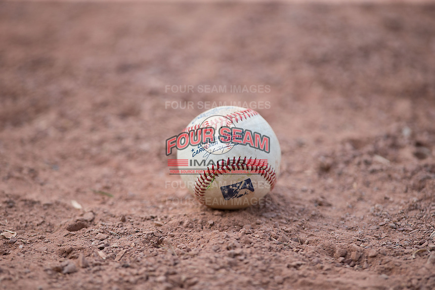 A Carolina League baseball lies on the ground during the game between the Salem Red Sox and the Winston-Salem Dash at BB&T Ballpark on May 31, 2015 in Winston-Salem, North Carolina.  The Red Sox defeated the Dash 6-5.  (Brian Westerholt/Four Seam Images)