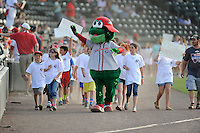 Mascot Reedy Rip'It of the Greenville Drive leads a parade before a game against the Charleston RiverDogs on Sunday, May 24, 2015, at Fluor Field at the West End in Greenville, South Carolina. Charleston won 3-2. (Tom Priddy/Four Seam Images)