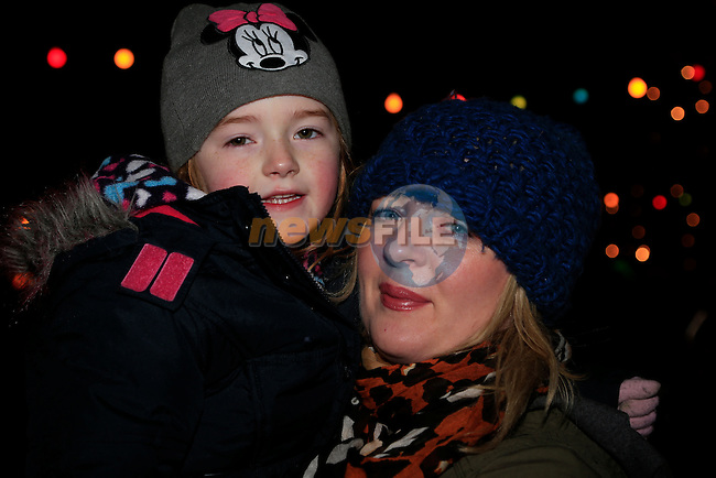 Orla Flynn and Niamh Smith in dunleer for the arrival of Santa<br /> Picture: Fran Caffrey www.newsfile.ie