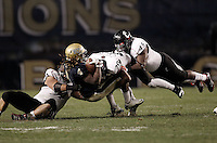 PITTSBURGH, PA - NOVEMBER 05:  Zach Brown #4 of the Pittsburgh Panthers is gang tackled by members of the Cincinnati Bearcats defense including Chris Williams #20 and Rob Trigg #45 on November 5, 2011 at Heinz Field in Pittsburgh, Pennsylvania.  (Photo by Jared Wickerham/Getty Images)