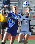 (Brockton MA 11/14/15)  Dover-Sherborn 15, Annika Linden, and  Medway10, Sarah DiPillo, after an air ball,  during  the division three south girls soccer final, Saturday, November 14, 2015, at Brockton High School. Herald Photo by Jim Michaud