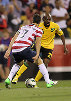 COLUMBUS, OHIO - SEPTEMBER 11, 2012:  Carlos Bocangra (3) of the USA MNT moves up on Luton Shelton (21) of Jamaica during a CONCACAF 2014 World Cup qualifying  match at Crew Stadium, in Columbus, Ohio on September 11. USA won 1-0.