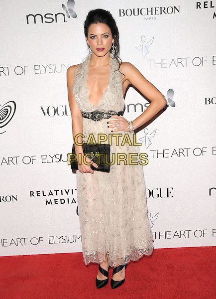 "JENNA DEWAN .at Art of Elysium 3rd Annual Black Tie charity gala '""Heaven"" held at 990 Wilshire Blvd in Beverly Hills, California, USA, January 16th 2010 .                                                                  arrivals full length long maxi dress low cut cleavage hand on hip clutch bag shoes halterneck black white lace grey gray .CAP/RKE/DVS.©DVS/RockinExposures/Capital Pictures"