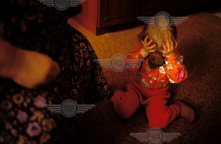 © Paul Lowe / Panos Pictures..Semipalatinsk, KAZAKHSTAN. ..Lida Soshetova and her mother Yulya at home.  Lida suffers from retinal blastoma, a malignant tumour that developed a year ago...On 29th August 1949 the first Russian plutonium bomb was exploded at the Semipalatinsk nuclear test site, which came to be known as 'The Polygon'. This first detonation was followed by more than 500 nuclear explosions, both atmospheric and underground..The effects in the Semipalatinsk region have been devastating. According to the UN more than 1.2 million people have been contaminated or are living in severely contaminated areas. Of these over 100,000 suffer from radiation related diseases. Even though testing stopped in 1989 the situation is continuing to deteriorate. Two out of every three children born in the region suffer from genetic defects.
