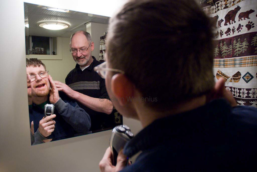 "Mark Pelletier helps Ben Brendahl shave on his own. Mark says he has always wanted to be a teacher, ""I just love the idea of figuring things out ... and then sharing it with someone. I get to do that pretty much every day."""