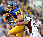 BROOKINGS, SD - NOVEMBER 6: Justin Syrovatka #23 of South Dakota State University is brought down by Skylar Smith #21 of Missouri State in the first quarter of their game Saturday afternoon at Coughlin Alumni Stadium in Brookings. (photo by Dave Eggen/Inertia)