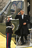 Washington, DC - February 16, 2009 -- United States President Barack Obama salutes the Marine Guard as he returns to the South Lawn of the White House aboard Marine 1after spending a week-end in Chicago, Illinois on Monday, February 16, 2009..Credit: Ron Sachs - Pool via CNP