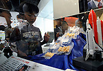 "School children look at a display of ""Space Ram"" noodles, which were developed by insrtant noodle maker Nissin and the National Space Development Agency for consumption in outer space, at the Momofuku Ando Instant Ramen Museum in Osaka, Japan on 20 October 2008. ""Space Ram"" were first carried aboard and consumed on a space shuttle by Japanese astronaut Soichi Noguchi in 2003.  ."