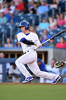 Tulsa Drillers catcher Ryan Casteel (32) at bat during a game against the Midland RockHounds on May 31, 2014 at ONEOK Field in Tulsa, Oklahoma.  Tulsa defeated Midland 5-3.  (Mike Janes/Four Seam Images)