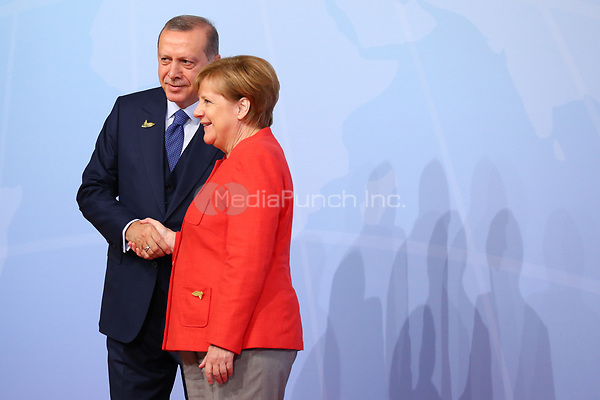 German chancellor Angela Merkel greets the Turkish president Recep Tayyip Erdogan at the G20 summit in Hamburg, Germany, 7 July 2017. The heads of the governments of the G20 group of countries are meeting in Hamburg on the 7-8 July 2017. Photo: Christian Charisius/dpa /MediaPunch ***FOR USA ONLY***