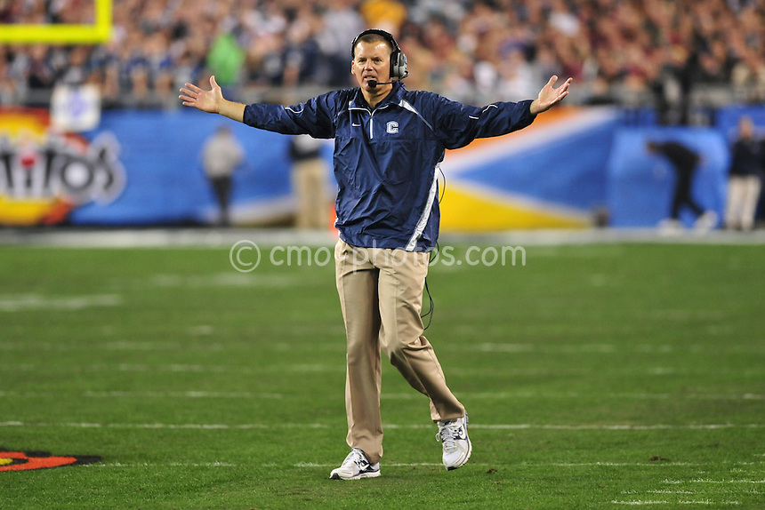 Jan 1, 2011; Glendale, AZ, USA; Connecticut Huskies head coach Randy Edsall gestures to an official about a pass interference penalty in the 1st quarter of the 2011 Fiesta Bowl against the Oklahoma Sooners at University of Phoenix Stadium.  The Huskies would not get the call and would later turn the ball over on downs.