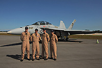 FORT LAUDERDALE FL - MAY 04: LT Christopher Walker, LT Stone Gregory, LT Jeffrey Mayer and LT Danielle Thiriot stand next too the U.S. Navy F/A-18F Super Hornet as it sits on the tarmac at Fort Lauderdale Executive Airport during Fort Lauderdale Air Show Media day on May 4, 2017 in Fort Lauderdale, Florida. Credit: mpi04/MediaPunch