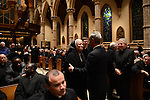 Mayor Rahm Emanuel greets a nun as priests from Chicago and around the nation and world arriving for the mass ahead of the installation ceremony of the Archbishop-elect of Chicago, Blase Cupich, at Holy Name Cathedral in Chicago, Illinois on November 18, 2014.  Cupich is the ninth Archbishop of Chicago and succeeds Cardinal Francis George.