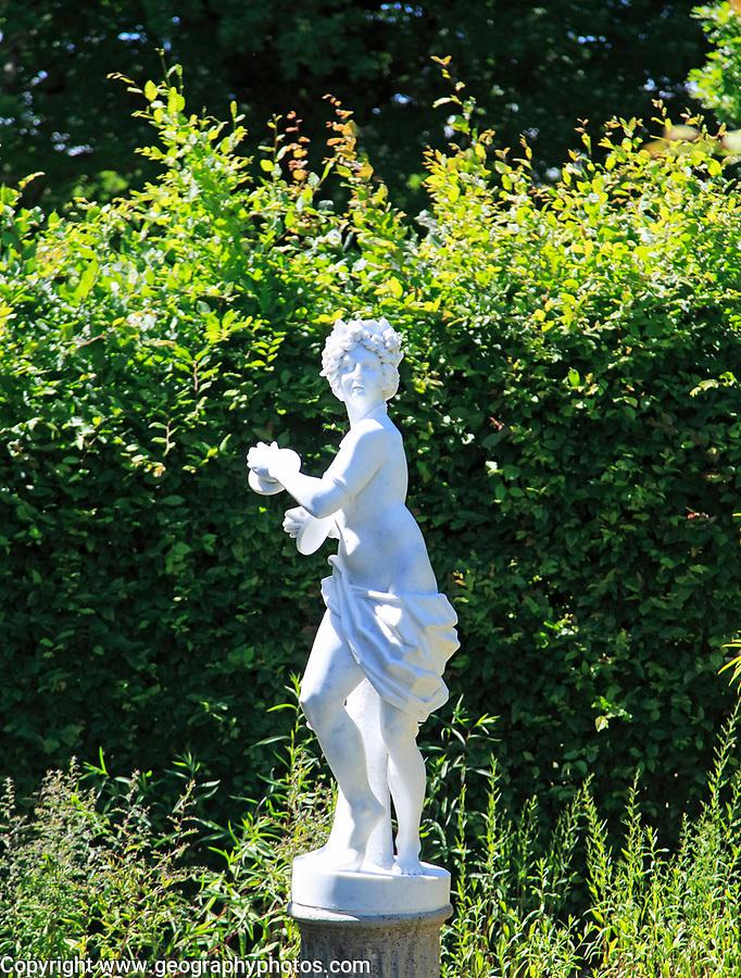 Classical statue of female figure, Sissinghurst castle gardens, Kent, England, UK