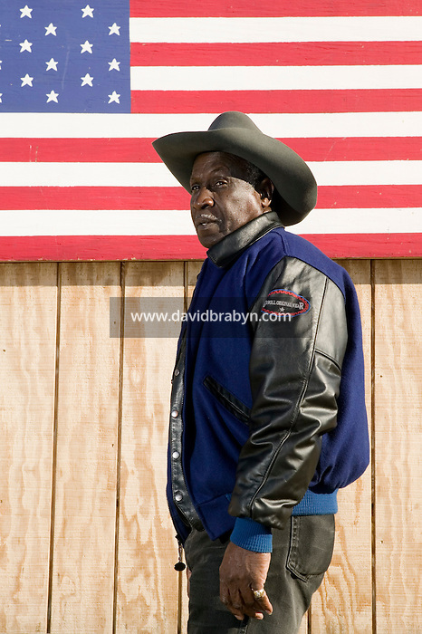 2 December 2006 - New York City, NY - Doctor D, a member of the Federation of Black Cowboys, poses for the photographer at the Cedar Lanes stables in the borough of Queens in New York City, USA, 2 December 2006. The Federation gathers black men and women who recreate the heritage of black cowboys, teach kids to ride and put on 'rodeo showdeos'.