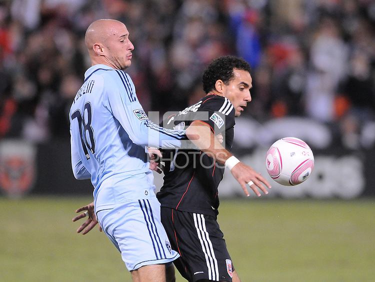 D.C. United forward Dwayne De Rosario (7)  shields the ball against Sporting Kansas City defender Aurelien Collin (78).  Sporting Kansas City defeated D.C. United 1-0 at RFK Stadium,Saturday October 22, 2011.