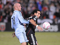 D.C. United forward Dwayne De Rosario (7)  shields the ball against Sporting Kansas City defender Aurelien Collin (78).  Sporting Kansas City defeated D.C. United 1-0 at RFK Stadium,Saturday October 22, 2011.