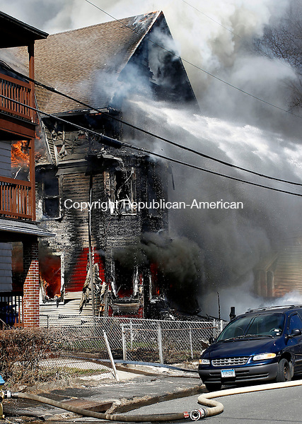 Waterbury, CT- 10 April 2014-041014CM02-  Waterbury firefighters put water on a multi-family home at 284 Hillside Ave. in Waterbury on Thursday. The two alarm fire destroyed the home and caused damage to nearby residences.     Christopher Massa Republican-American