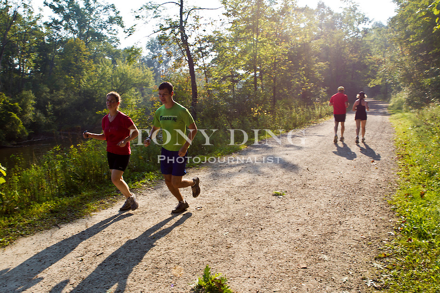 Runners take their morning jog through the University of Michigan's 123-acre Nichol's Arboretum (1610 Washington Heights; 734-647-8986; mbgna@umich.edu), Saturday, Sept. 3, 2011 in Ann Arbor, Mich. (Tony Ding for The New York Times)